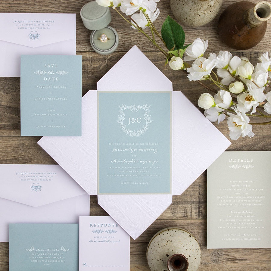 Shield of Dreams ponchette wedding invitation in sage green and robins egg blue