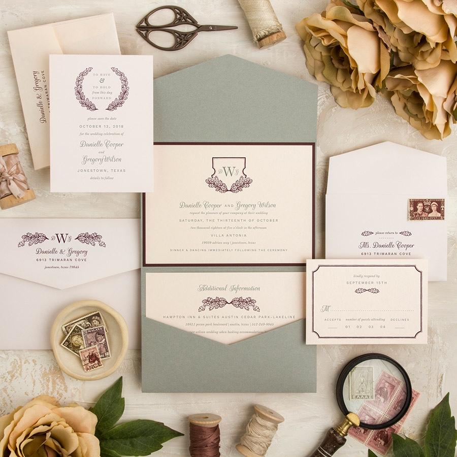 Wreath Shield layered pocket wedding invitation in wine and gray.
