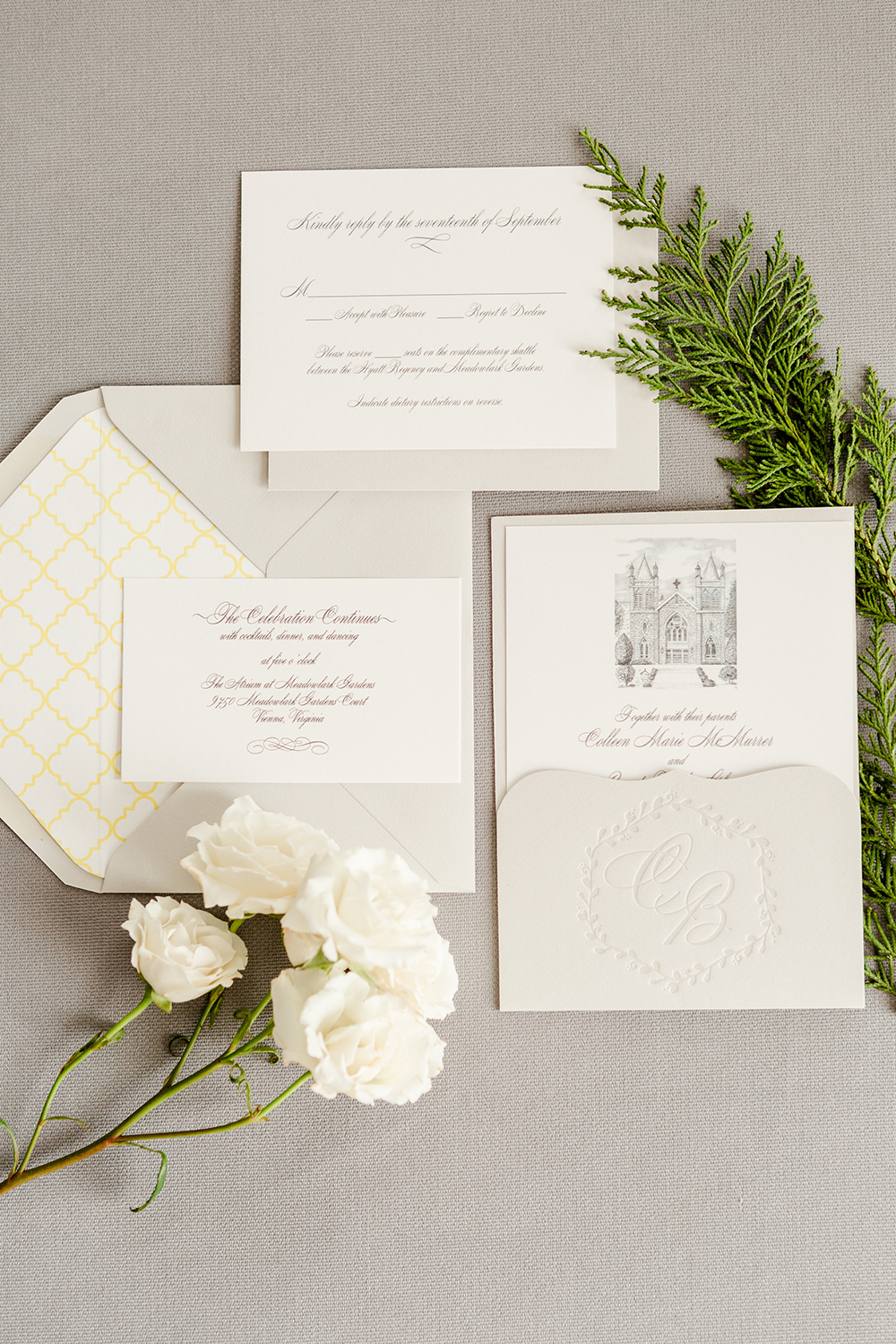 The bride's father's artwork of their ceremony church is the centerpiece for this stunning custom invitation that also features a letterpresses monogram on the pocket.