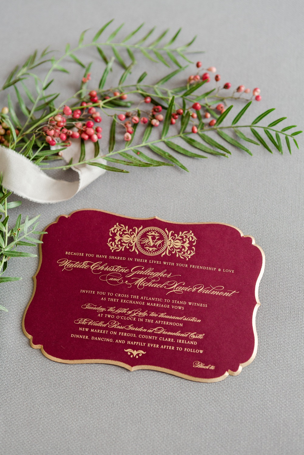 An ultra-thick engraved invitation features a painted beveled edge. Mailed in a luxurious silk-lined box.