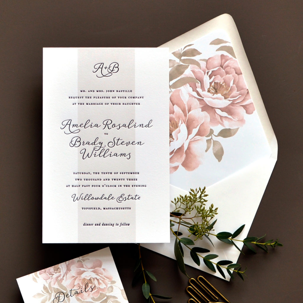 Letterpress and flat printed wedding invitation by smitten on paper uses stunning floral accents in the envelope liner and one of the inserts.