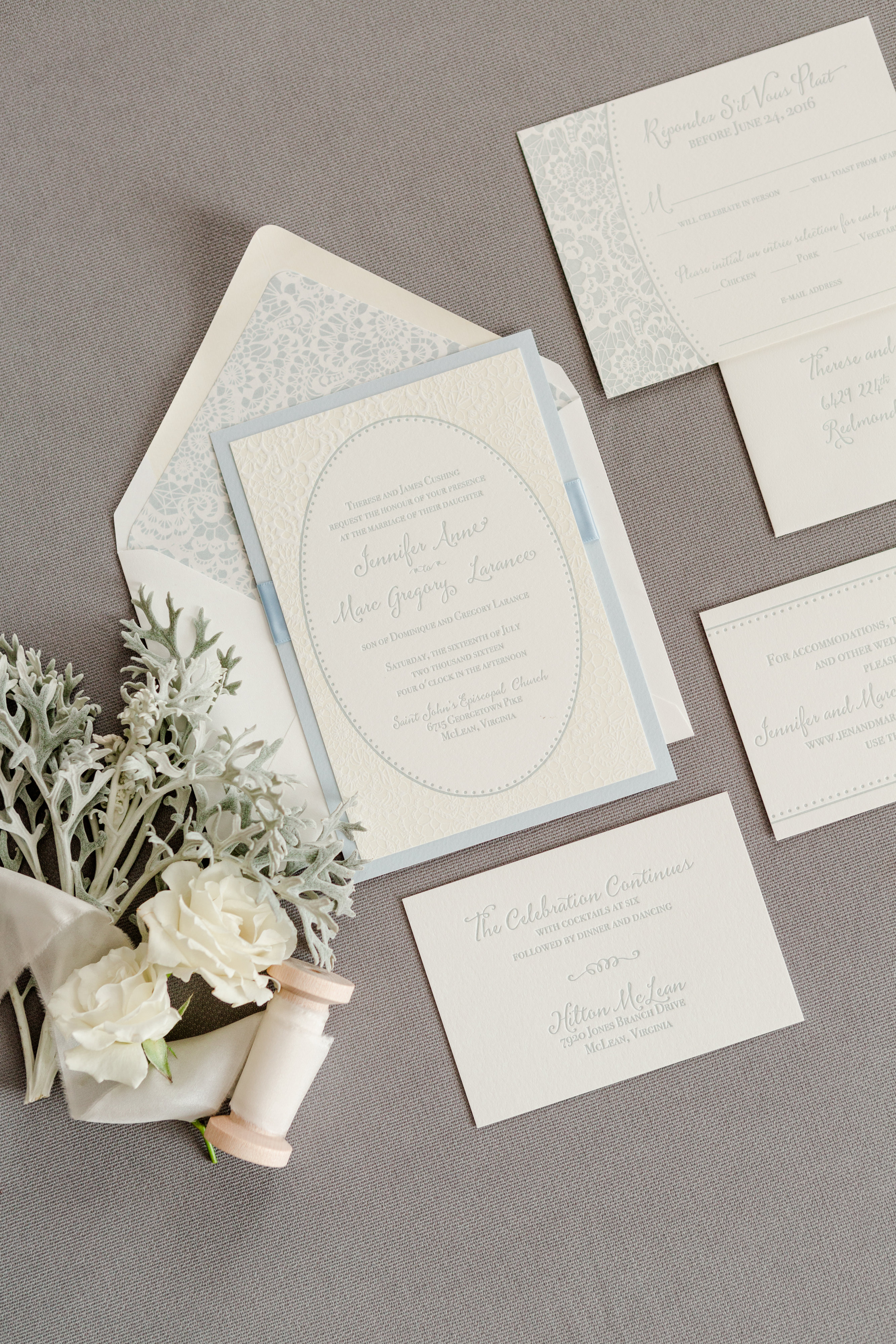 Layered & embellished 2-color letterpress wedding invitation features lace pattern and soft blue color.
