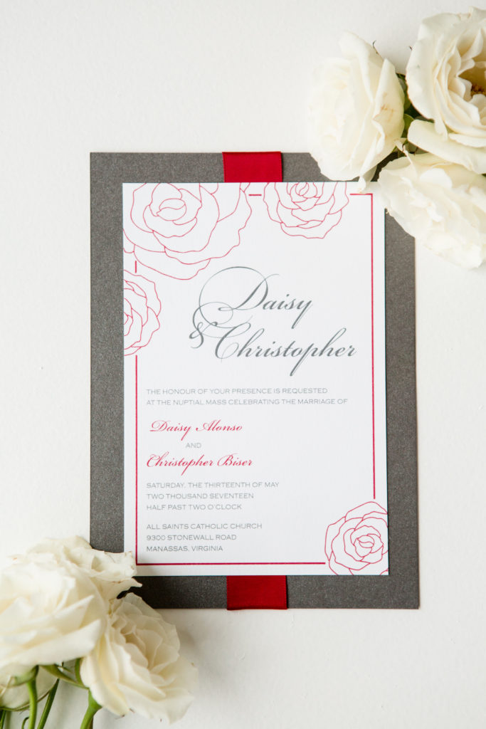 2-color thermography wedding invitation layered onto metallic gray and accented with a red ribbon.