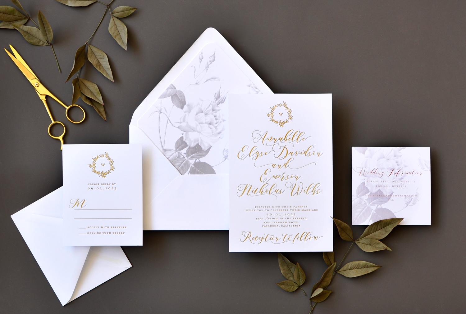 Annabelle foil stamped wedding invitation features calligraphy and an ornate monogram