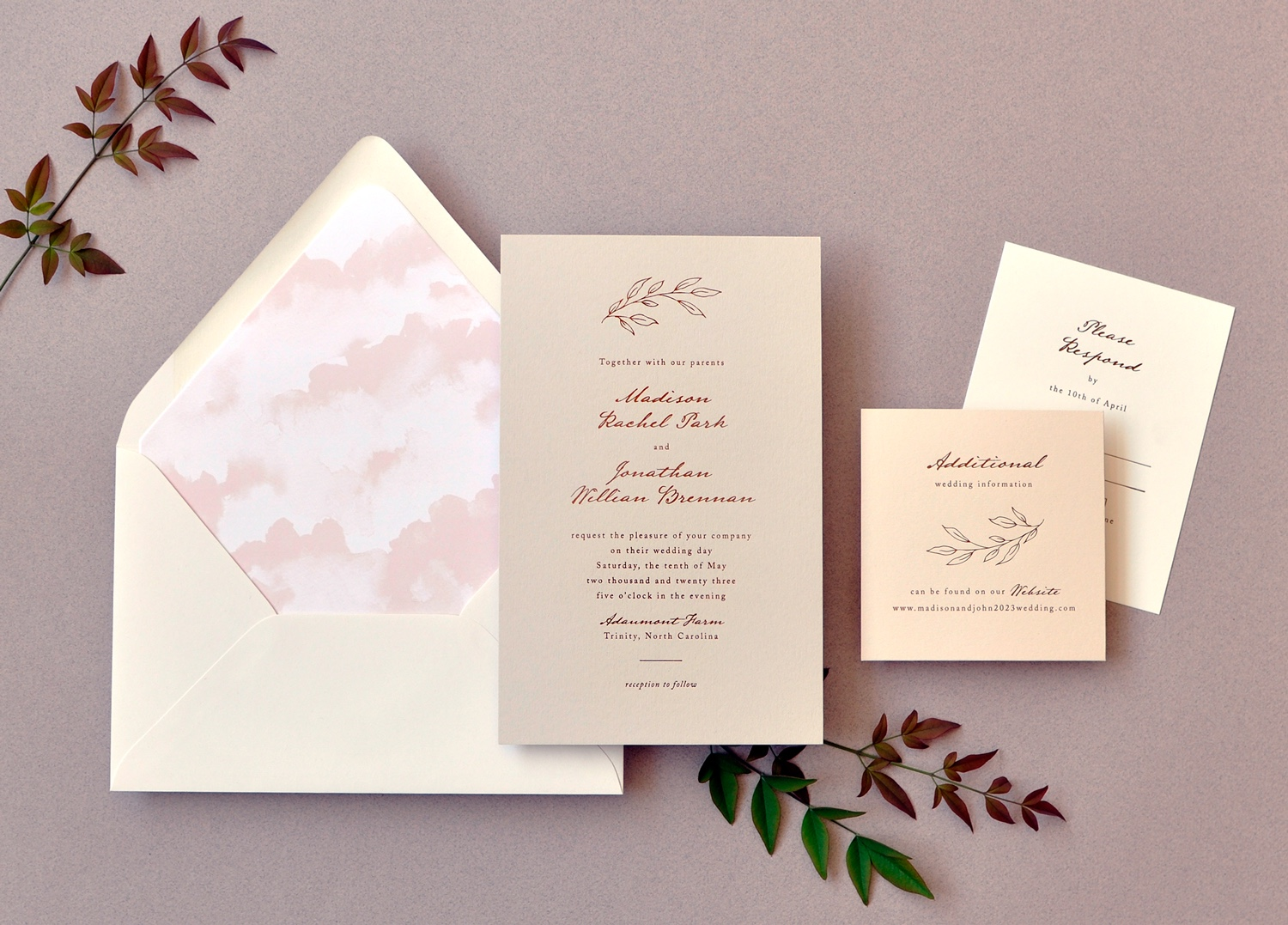 Shades of stone and cream, Madison, a luxury folil stamped wedding invitation features a delicate tree branch and a cloud-like envelope liner.
