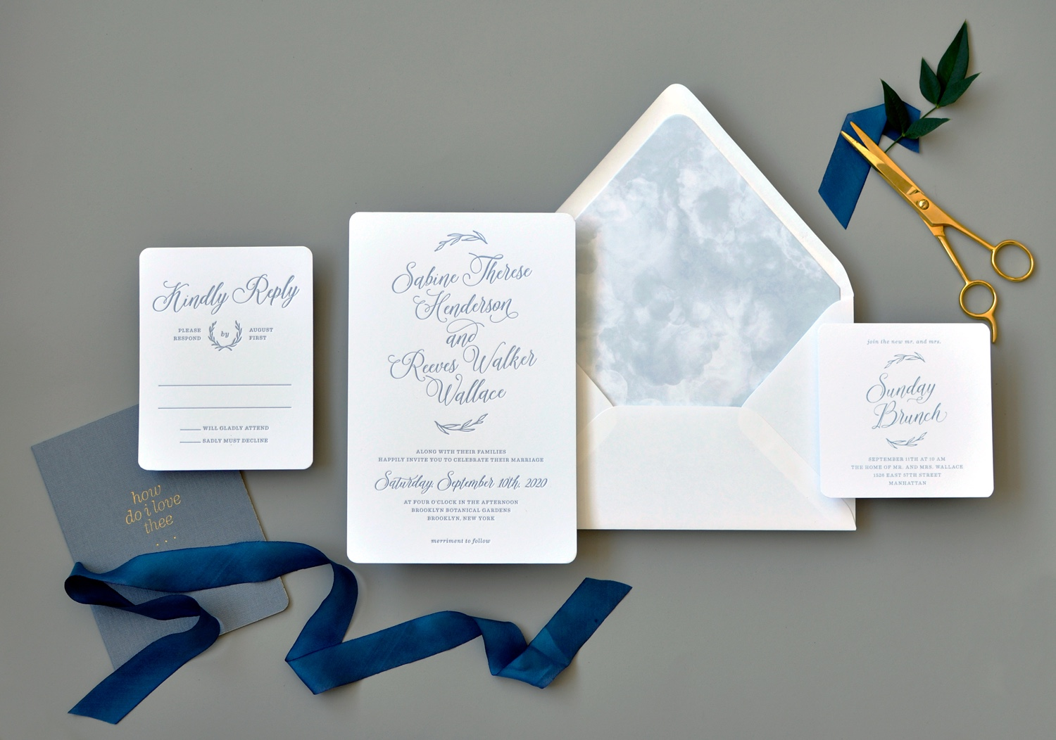 Sabine luxury letterpress wedding invitation features beautiful calligraphy and a watercolor envelope liner in a dusty blue.  Wedgwood blue