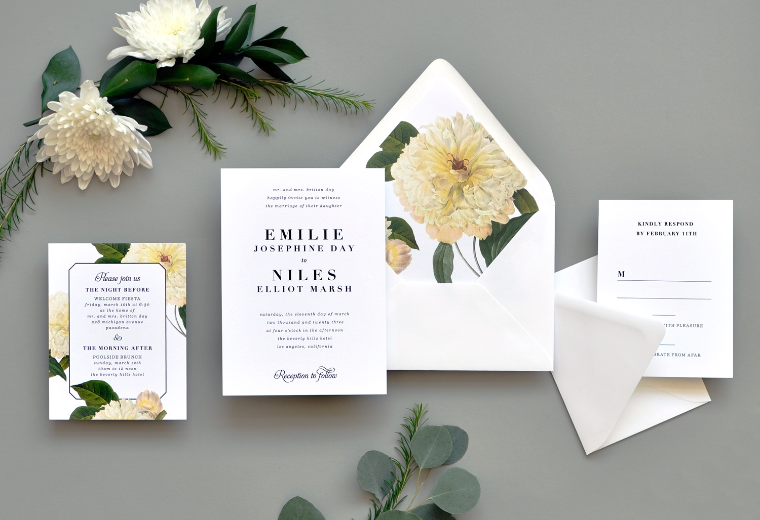 A simple wedding invitation is perfectly paired with a bold floral envelope liner featuring a large mum.