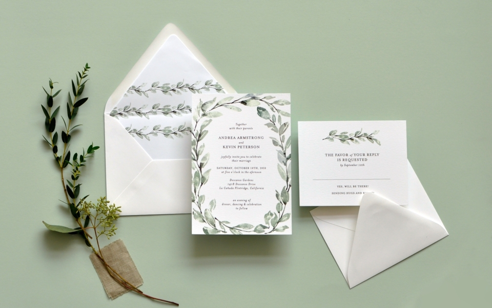 Delicate Willow wedding invitation features a watercolor wreath of treen branches around a contemporary text setting.  Vertical vines on the envelope liner and accenting the inserts tie the ensemble together seamlessly.