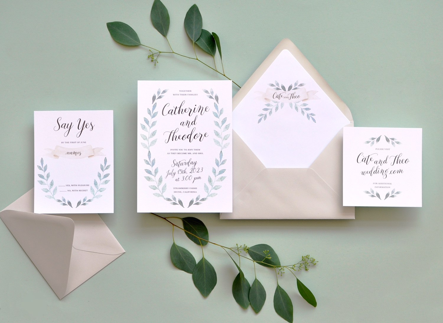 A watercolor laurel of greenery frames a calligraphy script.  Personalized envelope liner features greenery and a blush banner.  Perfectly paired with light gray envelopes.