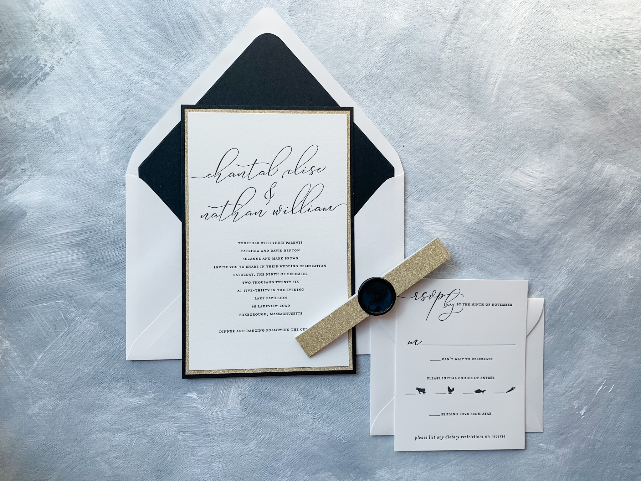 Layers of black and glitter gold accent this contemporary black letterpress wedding invitation available in the DC area at Staccato