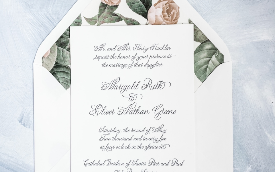 All script letterpress wedding invitation with a muted floral envelope liner gives this invitation a vintage yet contemporary feel.  SOP Invitations are available at Staccato in Fairfax, VA.