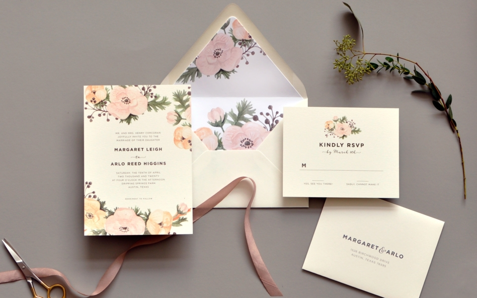 Blush colored watercolor flowers are the highlight of this soft and delicate flat printed wedding invitation.