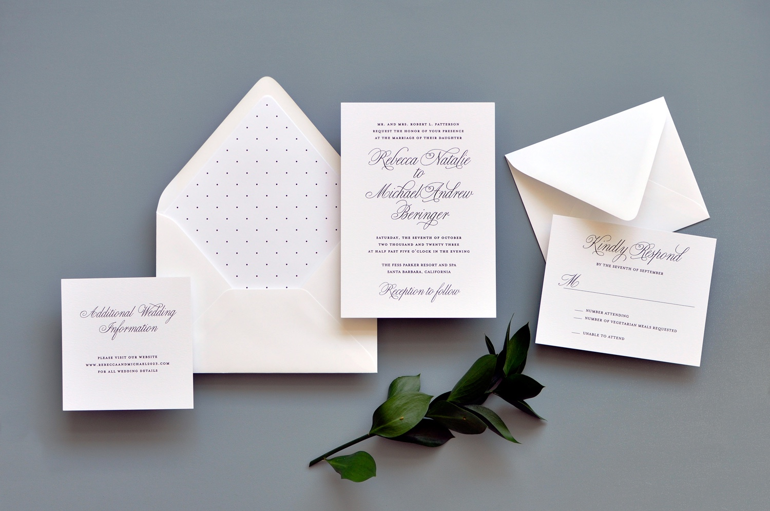 A formal script is the highlight of this traditional wedding invitation.  A subtle polka dot envelope liner adds a whimsical flare.