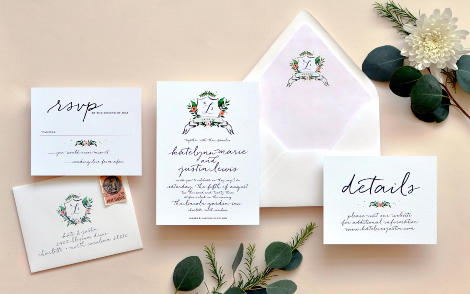 A casual watercolor floral crest with banner is the perfect introduction of your soon-to-be new family. A casual script in all lower case lettering is a lovely text setting.