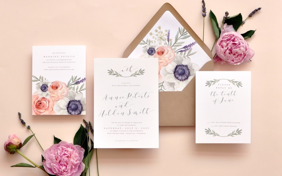 Bright but muted floral colors on the envelope liner and details insert are a dramatic backdrop to this understated, earthy wedding invitation