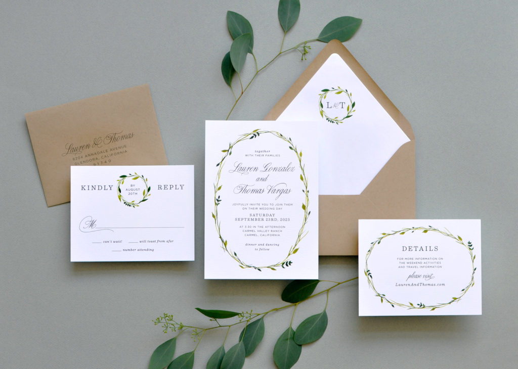 Wreath of thin vines surrounds the text of this contemporary wedding invitation.  A monogramed envelope liner and little accents of greenery throughout.