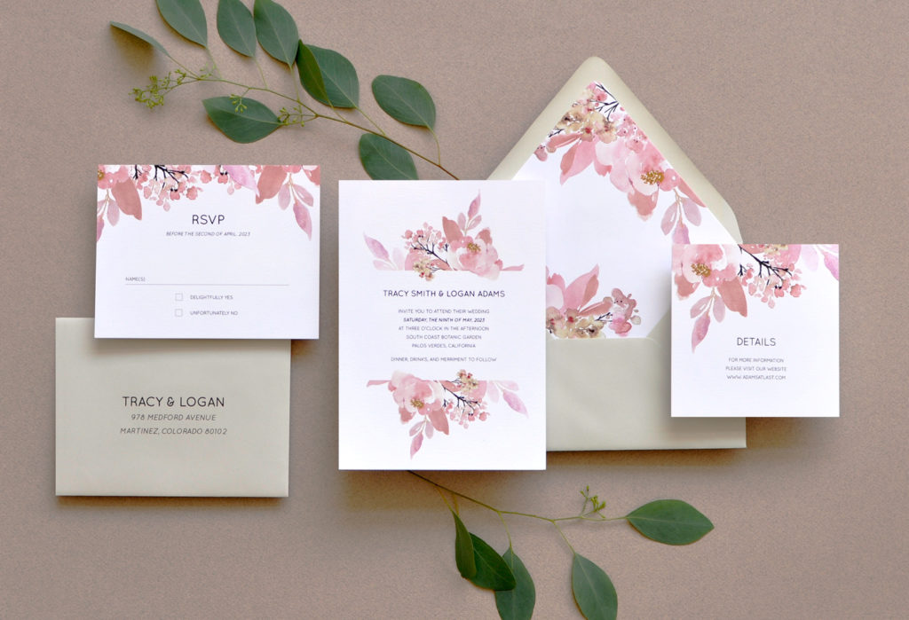 Love Abloom floral flat printed wedding invitation features beautiful watercolor floral sprays in a dusty rose color.  Accented perfectly with pale gray envelopes and contemporary text setting.