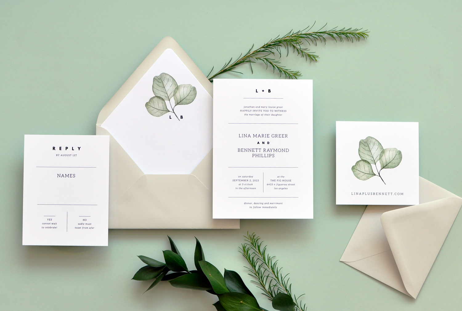 Contemporary text setting with dividing lines and a bold monogram pairs nicely with botanical skeleton leaves in a sage green.