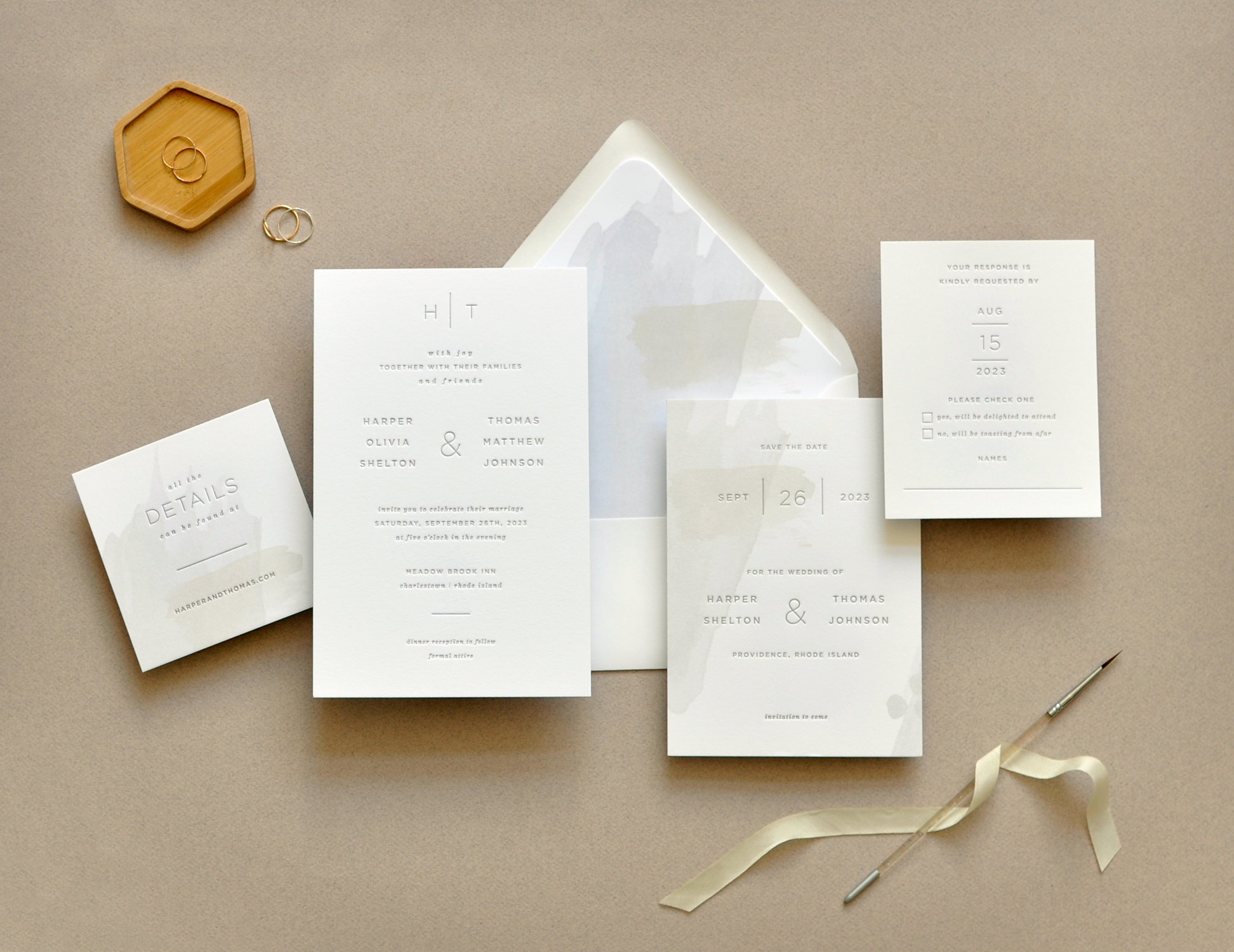 Contemporary wedding invitation in one color letterpress features watercolor brush stroke accents on the insert card and envelope liner. Staccato serves clients in Virginia, Maryland, Washington DC, and nationwide.