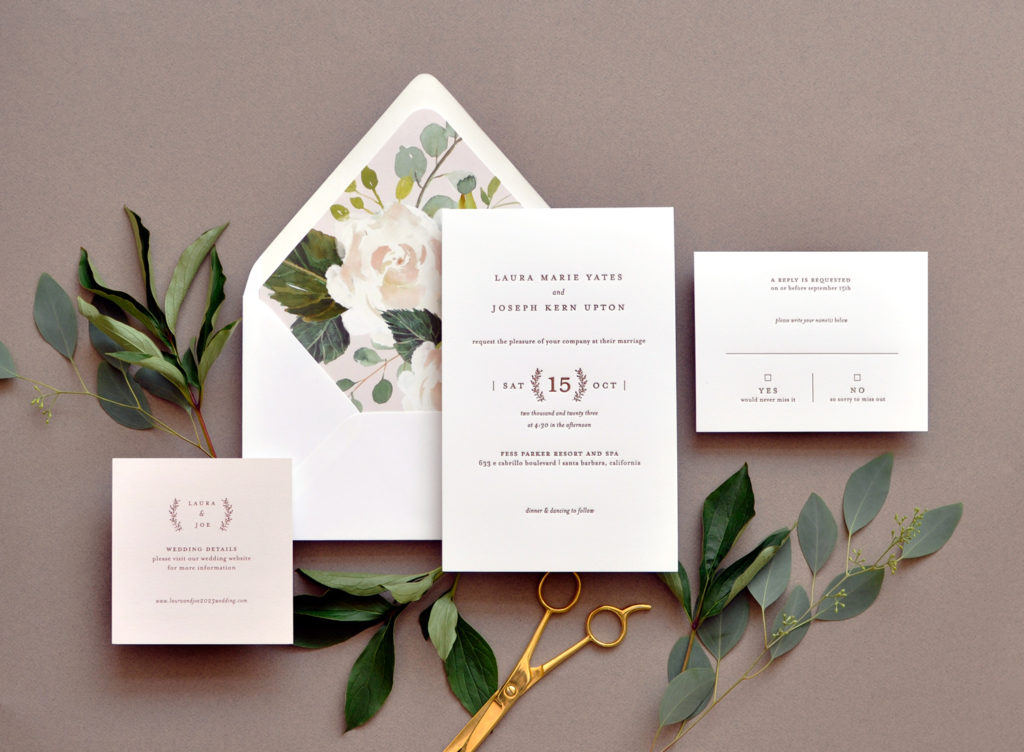 Laura luxury letterpress wedding invitation features contemporary text setting and is paired with a beautiful botanical floral envelope liner.  Available at Staccato in Northern Virginia.
