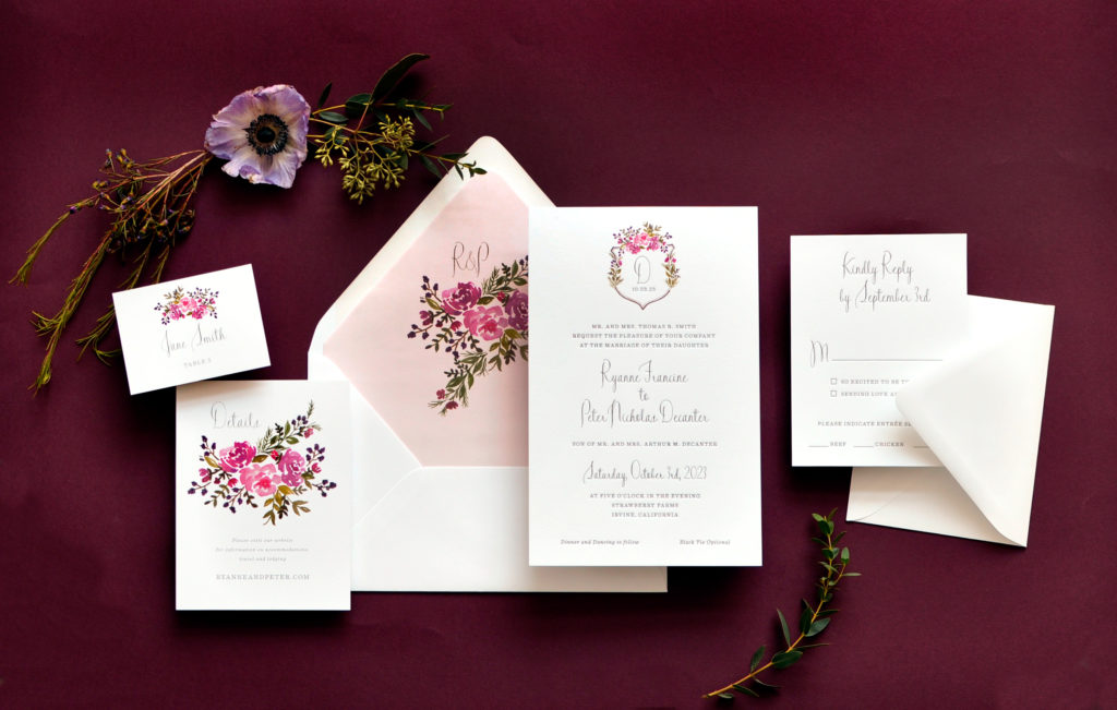 Delicate flowers adorn the monogram at the top of this sweet wedding invitation design.  Staccato serves wedding invitation clients in Fairfax, Virginia and Nationwide.