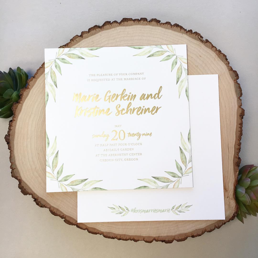 A pretty watercolor leaf design embellished the corners of this contemporary foil stamped wedding invitation.