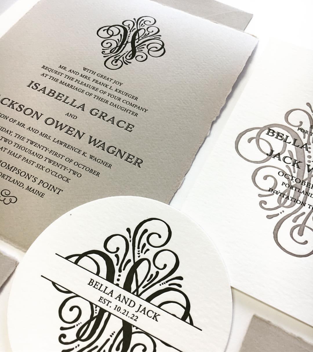 Stunningly ornate monogram is the focus of this beautiful textured invitation suite.