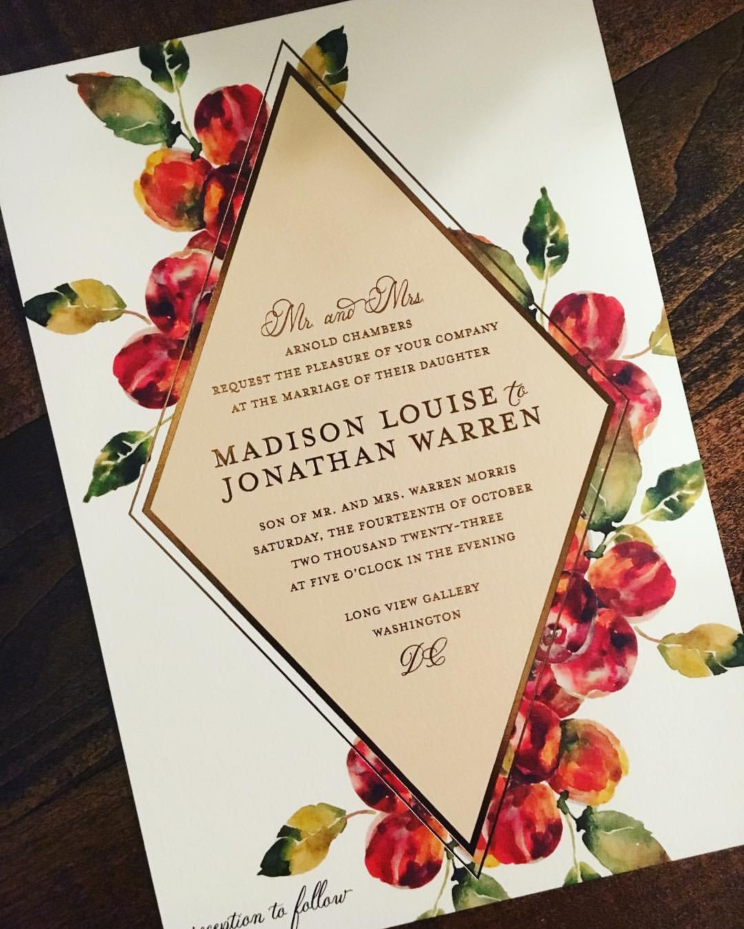 beautiful watercolor berries behind a diamond with bronze foil stamped text.