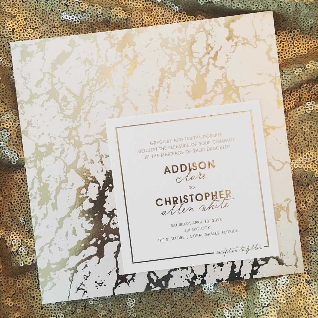 Stunning marble texture is foiled in the background of this square wedding invitation.
