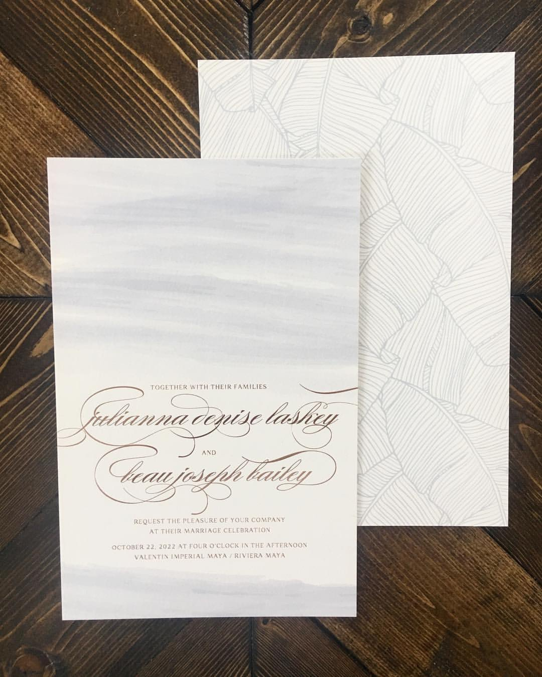 Pretty pale watercolor background with elegant gold foil text on this luxury wedding invitation