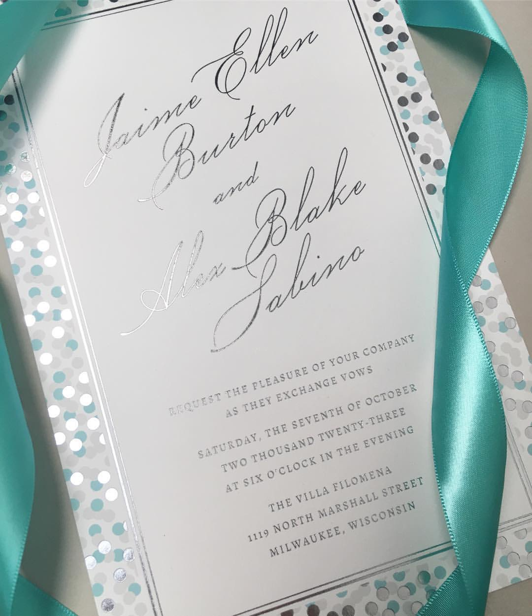 Beautiful foiled confetti is the border of this modern wedding invitation