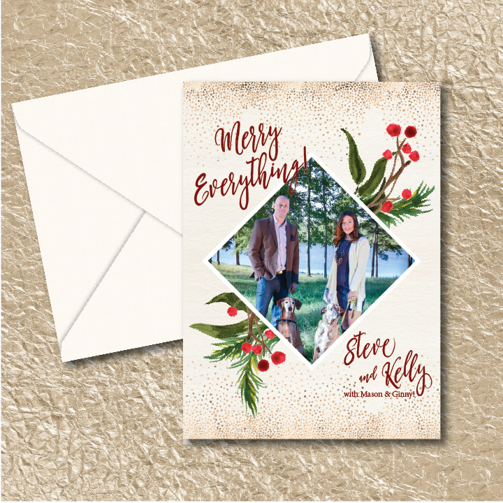 A diamond shaped photo is surrounded by boughs of greenery with holly berries. Merry Everything!