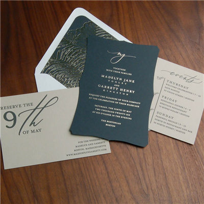 A truly modern, impactful wedding invitation design! This gently scalloped die cut invitation features a modern lowercase script monogram and contemporary text setting.  The foil stamped envelope liner adds to the drama!
