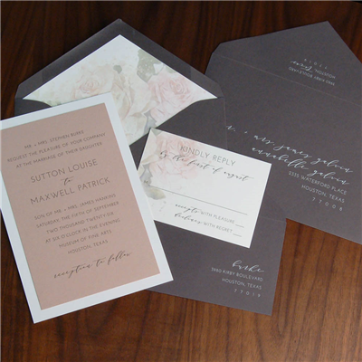 Dusty pink layered to white makes an unexpected impression on this wedding invitation suite!  Gray envelopes use a very modern right-justified address layout and roses in the envelope liner.