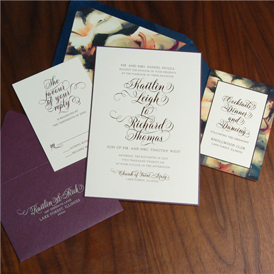 A bold color pallet of navy and purple sets the tones for this modern wedding invitation that is full of flourishes and fine details.