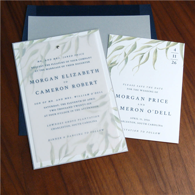 Staccato is now offering this beautiful invitation with wispy greenery branches.  A text is printed on vellum and layered with a pretty brad to the botanical backing layer.  Navy envelope with gray envelope liner.