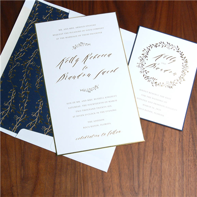 Featuring gold foil stamped vines and navy accents, this wedding invitation really stands out with a beveled and foiled edge.
