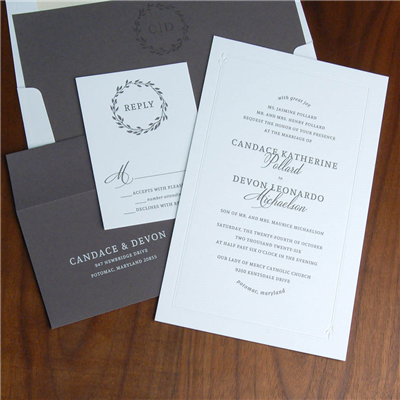A blind embossed frame with just a little gentle leaf motif borders this invitation with modern text setting and gray accents.  White ink printing on charcoal envelopes really pop!