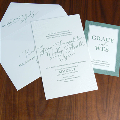 Blind debossing, angled modern script names, and a a dramatic envelope make this letterpress wedding invitation one to be remembered! Fern or palm greenery.