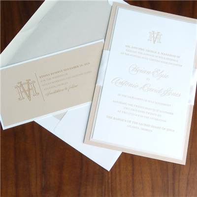 3 strong layers and a wide ribbon accent make the Emblema wedding invitation a true standout.  Traditional text setting with a nested monogram.