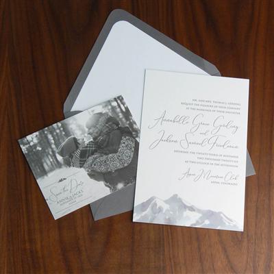 Precipice wedding invitation features watercolor mountain artwork across the bottom and a modern, clean script.