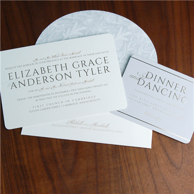 A bold, yet pretty horizontal wedding invitation features a blend of delicate script and block text.  Rounded corners and a unique oval flap envelope.
