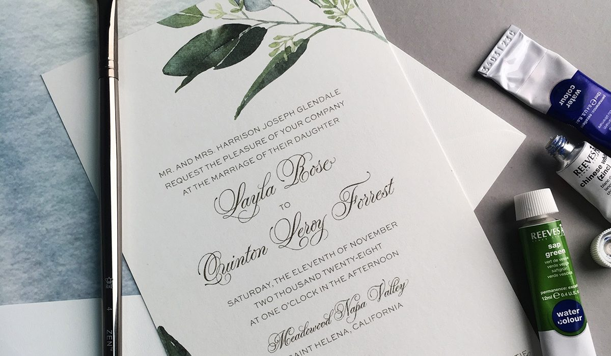 Beautiful sprays of sage green leaves adorn the corners of this pretty thermography and digitally printed wedding invitation.  Luxury wedding invitations from Staccato, serving northern Virginia.