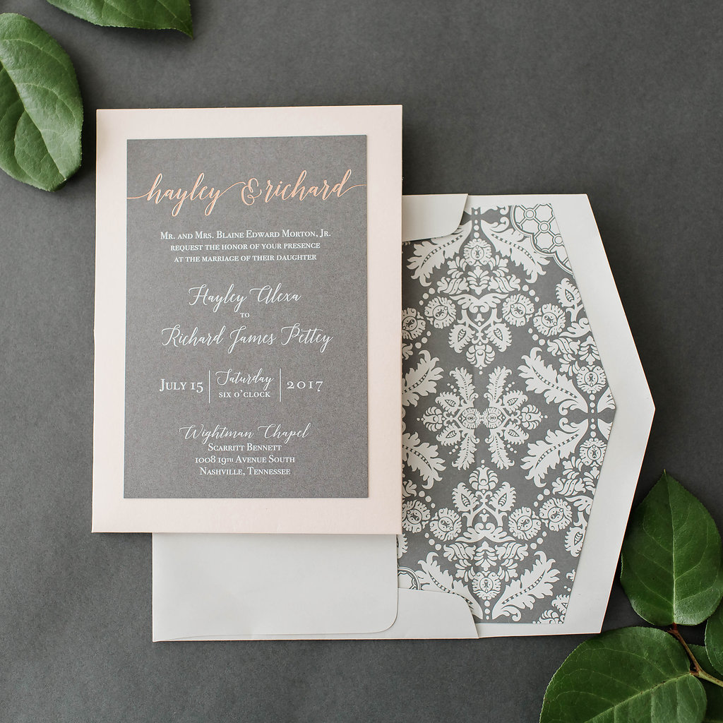 white ink and rose gold foil are beautiful on this charcoal wedding invitation