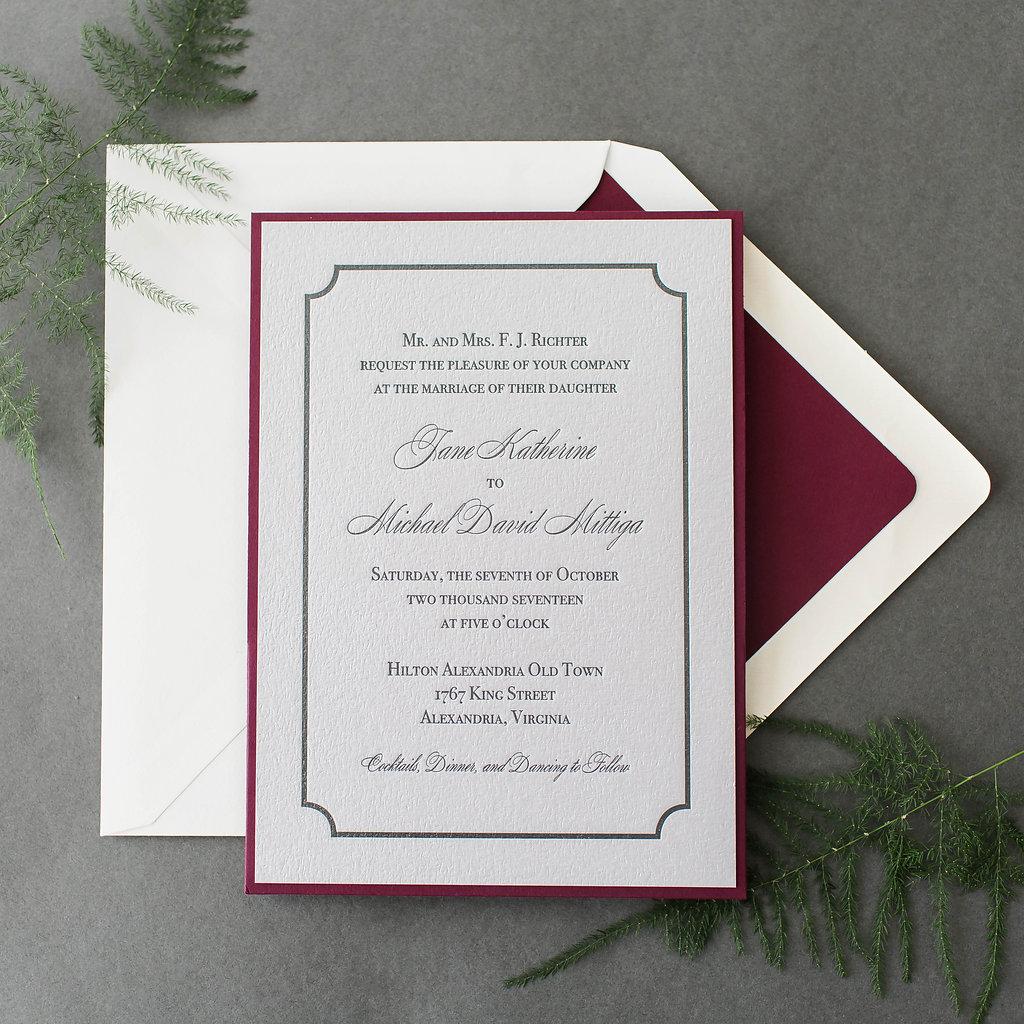 custom letterpress wedding invitation layered onto a wine colored pocket