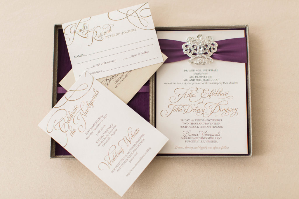 Atlas & Detroy's custom glitter box rhinestone brooch wedding invitation in a purple silk-lined box