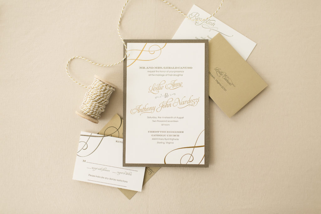 letterpress wedding invitation with gold foil accents. pearl white layered onto olive green.