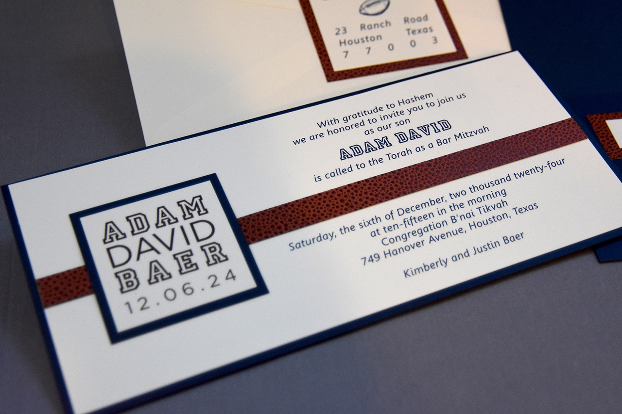Adam David bar mitzvah invitation features a stripe of basketball textured paper and a layered badge.