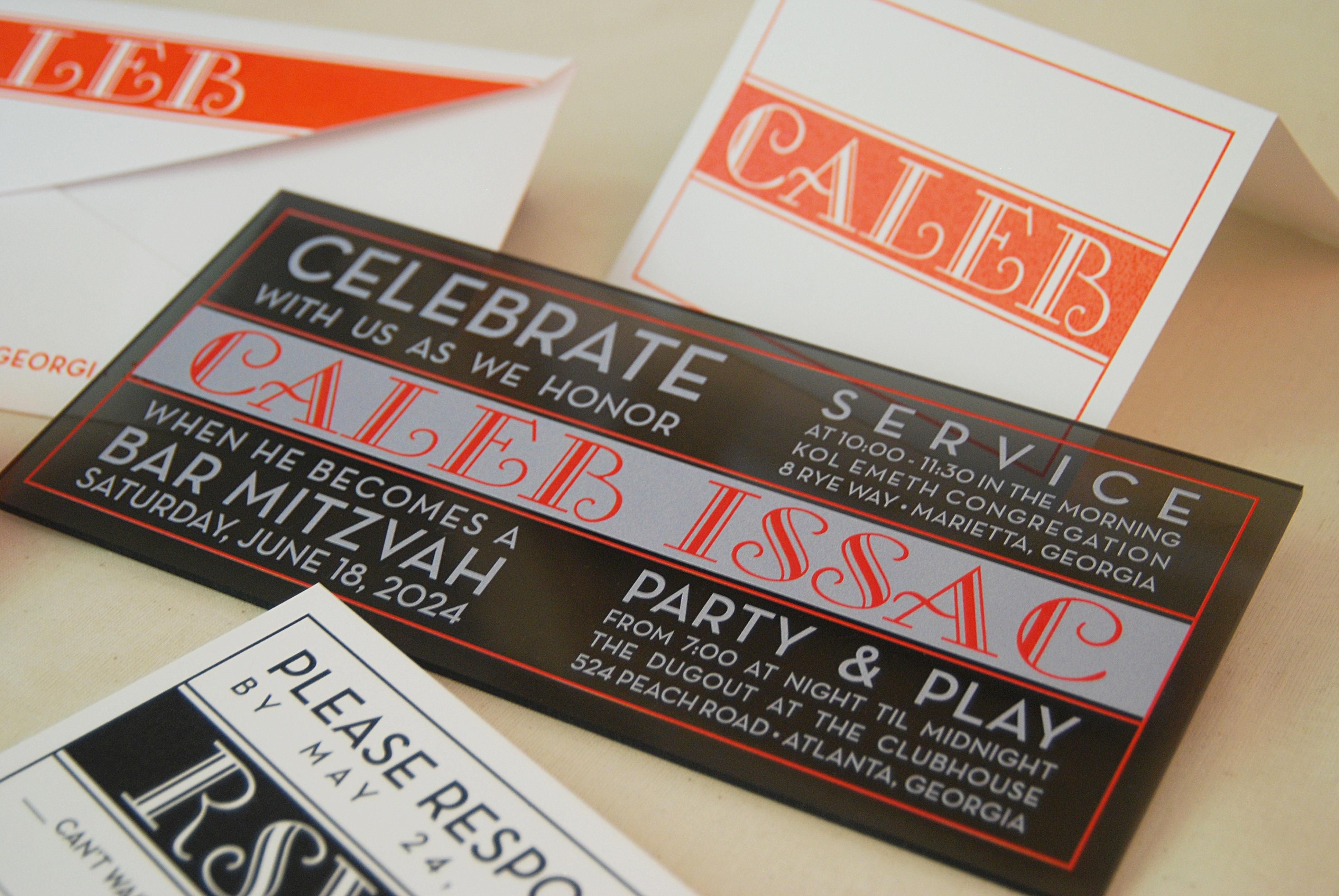 Caleb Issac  Black, red, and silver bar mitzvah invitation. Available in the Washington DC area at Staccato
