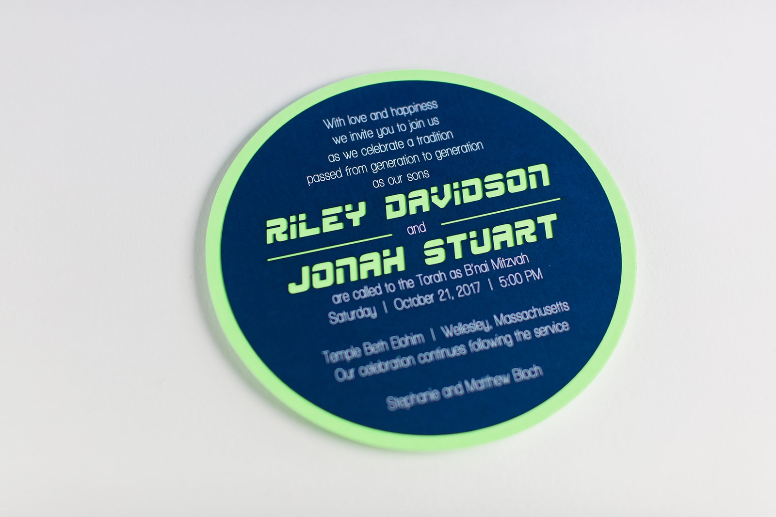 modern layered circle, racy lettering style, and bold navy and lime green colors are perfect for these b'nai mitzvah boys!